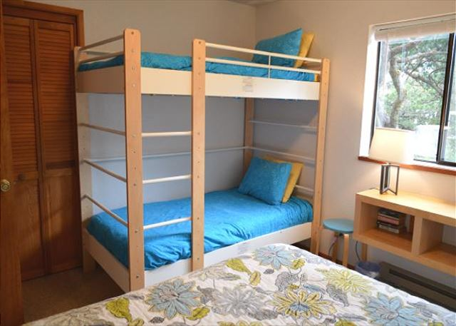 Entry level bedroom with Twin Bunk and Queen bed with full size closet.