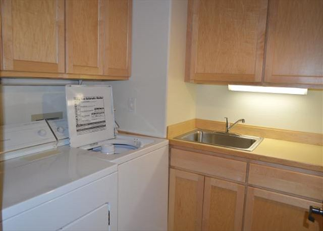 Laundry room with utility sink.