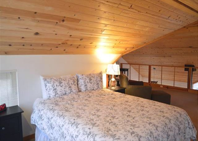 Loft sleeping area.  Queen bed as well as a queen size futon.
