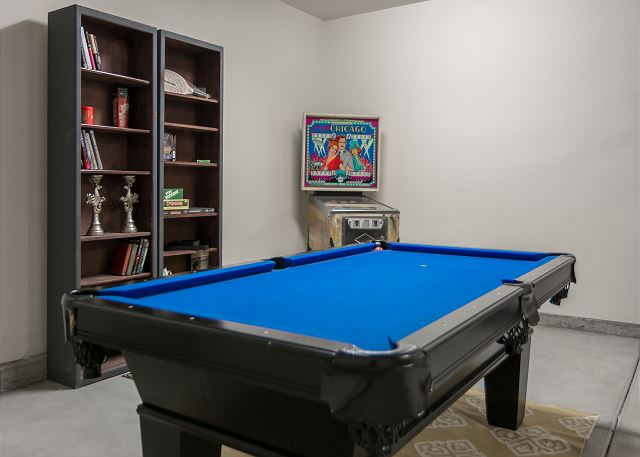 the garage in the space where the 3rd car or golf cart parking would be there is parking still for 2 cars the pool table is a bar regulation size