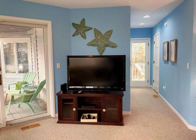 Den Mid Level of Sandy Heels, a 4 bedroom, 3.5 bathroom vacation rental in Corolla, NC