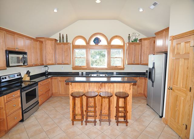 Kitchen Top Level of A Perfect 10, a 6 bedroom, 5.5 bathroom vacation rental in Corolla, NC