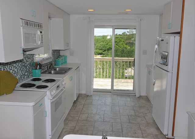 Kitchen Top Level Sunset Strip is a 5 bedroom, 3.0 bathroom vacation rental in Corolla, NC