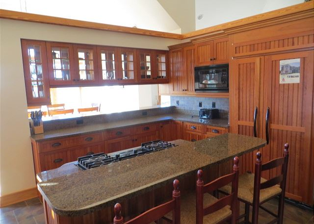 Kitchen Top Level of The Sound and The Fury, a 6 bedroom, 6.5 bathroom vacation rental in Corolla, NC