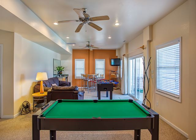 Game Area Ground Level of Just Peachy, a 4 bedroom, 4.5 bathroom vacation rental in Kill Devil Hills, NC