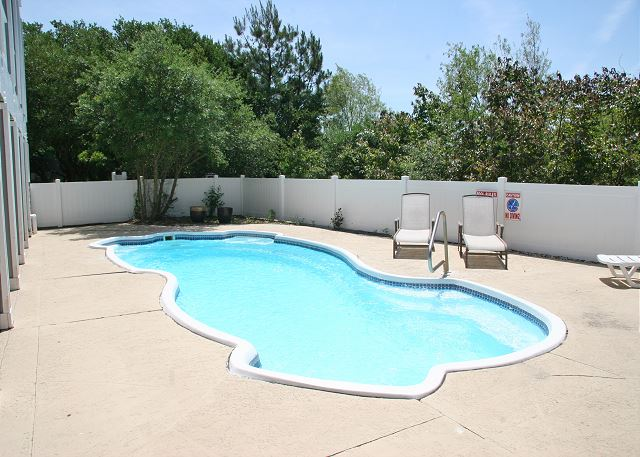Pool patio of Summerland, a 5 bedroom, 5.5 bathroom vacation rental in Corolla, NC