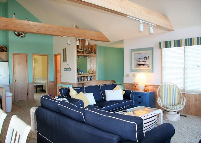 Living Room Top Level of Neely's Beach Music, a 5 bedroom, 3.5 bathroom vacation rental in Corolla, NC