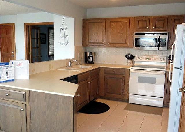 Kitchen Mid Level of Utopia, a 5 bedroom, 5.0 bathroom vacation rental in Duck, NC
