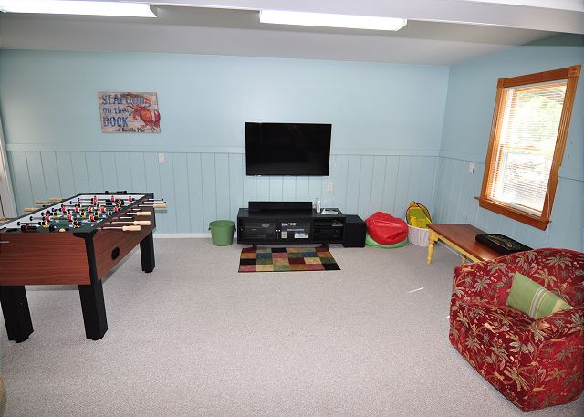 Game Room Ground Level of Serendipity, a 5 bedroom, 4.5 bathroom vacation rental in Corolla, NC