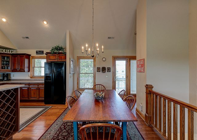 Dining area top level of Southern Breeze, a 5 bedroom, 4.5 bathroom vacation rental in Corolla, NC
