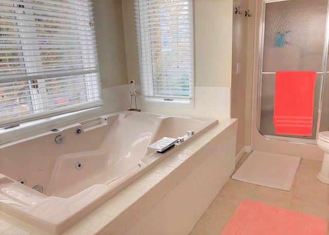 King Master Bathroom Top Level Sandy Heels is a 4 bedroom, 3.5 bathroom vacation rental in Corolla, NC