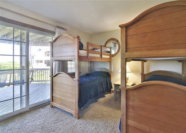 Bunk Bedroom Mid Level Waterlily is a 5 bedroom, 5.5 bathroom vacation rental in Corolla, NC