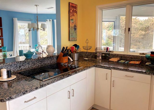 Kitchen Top Level Sandy Heels is a 4 bedroom, 3.5 bathroom vacation rental in Corolla, NC