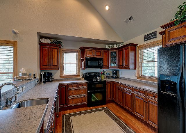 Kitchen top level of Southern Breeze, a 5 bedroom, 4.5 bathroom vacation rental in Corolla, NC