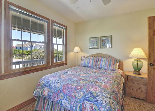 Queen Bedroom Mid Level Waterlily is a 5 bedroom, 5.5 bathroom vacation rental in Corolla, NC