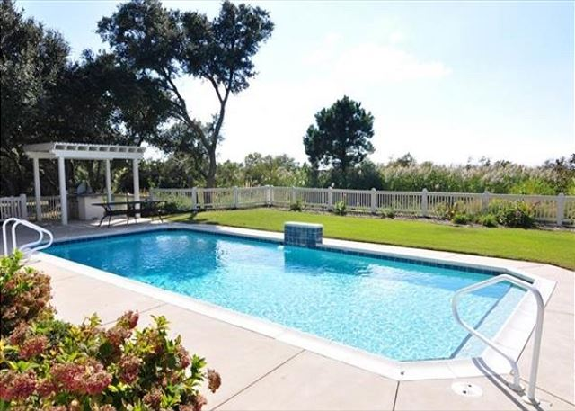 Pool Patio of The Sound and The Fury, a 6 bedroom, 6.5 bathroom vacation rental in Corolla, NC