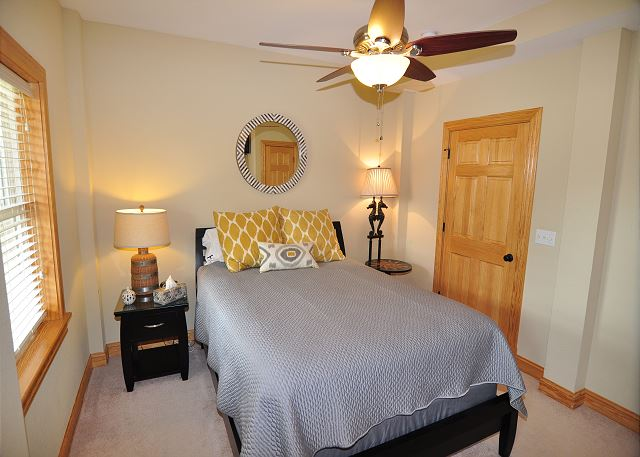 Queen Master Ground Level of Sand Simeon, a 7 bedroom, 7.5 bathroom vacation rental in Corolla, NC