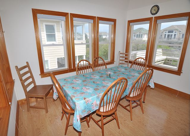 Dining Area Top Level OB Wave is a 5 bedroom, 3.5 bathroom vacation rental in Corolla, NC