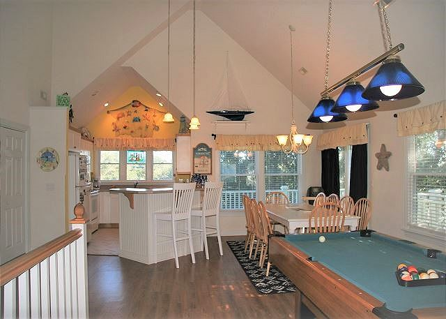 Game Area Top Level of Paradise Cay, a 5 bedroom, 3.5 bathroom vacation rental in Corolla, NC
