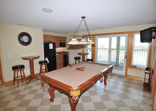 Game Room Ground Level of Sand Simeon, a 7 bedroom, 7.5 bathroom vacation rental in Corolla, NC