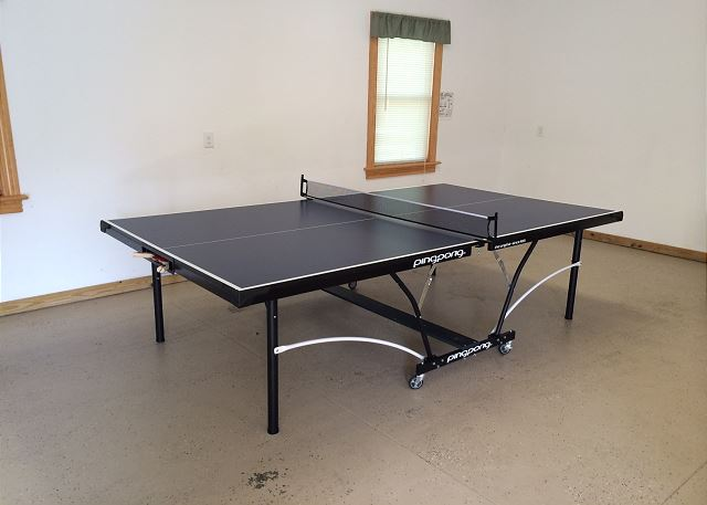 Ping Pong Table Garage of Wood Duck Inn, a 5 bedroom, 4.5 bathroom vacation rental in Corolla, NC
