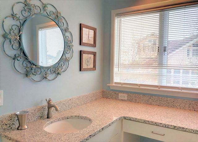King Master Bathroom Mid Level Sandy Heels is a 4 bedroom, 3.5 bathroom vacation rental in Corolla, NC
