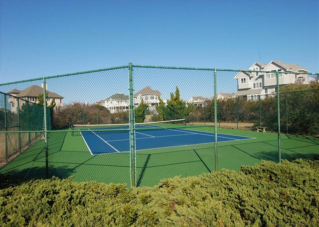 Pine Island Tennis Courts of Full House, a 5 bedroom, 4.5 bathroom vacation rental in Corolla, NC
