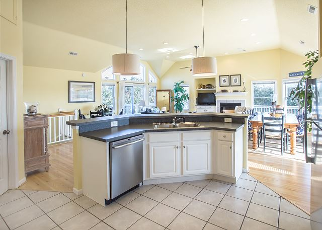 Kitchen Top Level Summerland is a 5 bedroom, 5.5 bathroom vacation rental in Corolla, NC