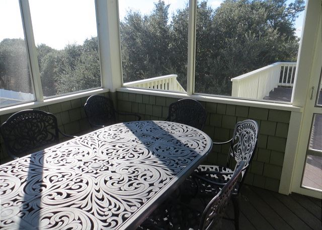 Screened In Porch Top Level of The Sound and The Fury, a 6 bedroom, 6.5 bathroom vacation rental in Corolla, NC