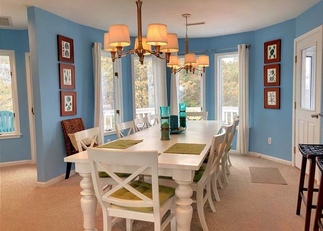 Dining Room Top Level Sandy Heels is a 4 bedroom, 3.5 bathroom vacation rental in Corolla, NC