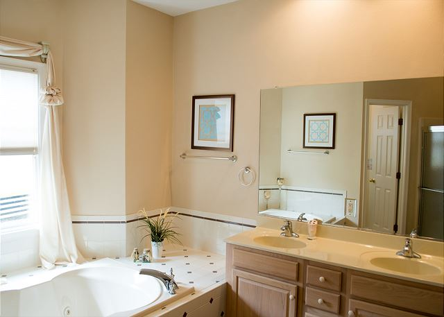 Queen Master Bathroom Entry Level of Sugar Shack, a 4 bedroom, 3.0 bathroom vacation rental in Corolla, NC