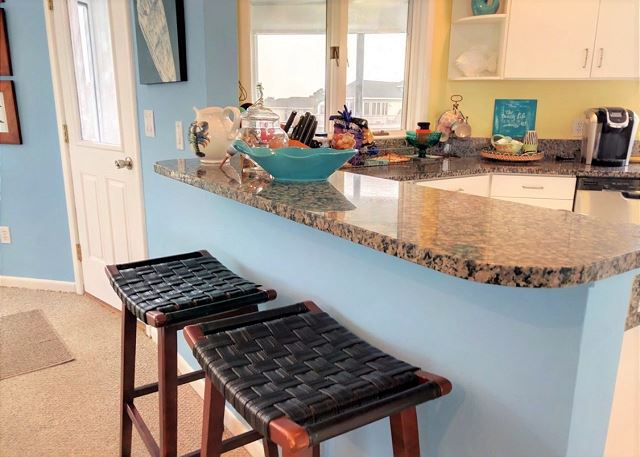 Kitchen Bar Top Level Sandy Heels is a 4 bedroom, 3.5 bathroom vacation rental in Corolla, NC
