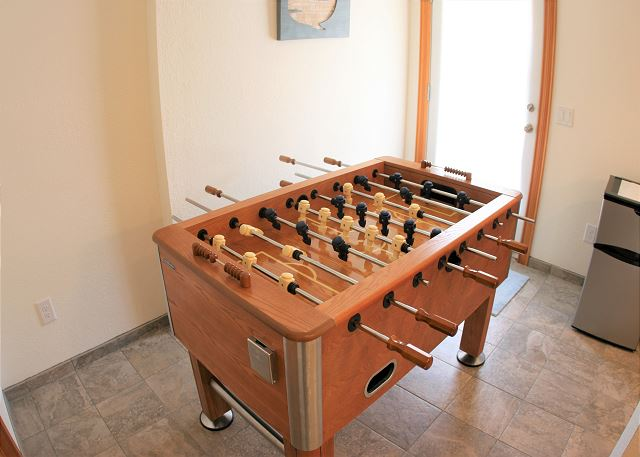Foosball table Ground Level  of OB Wave, a 5 bedroom, 3.5 bathroom vacation rental in Corolla, NC