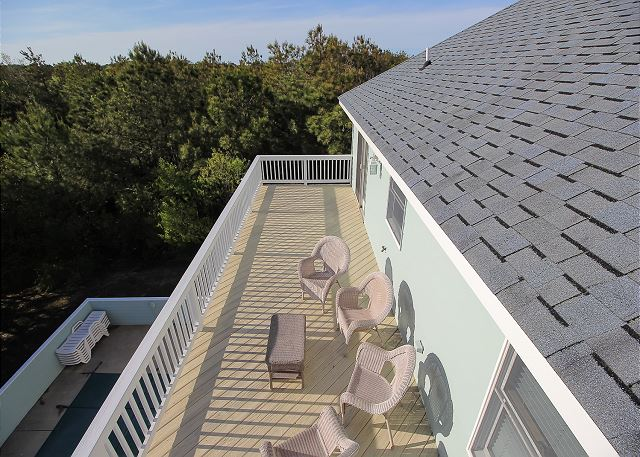 Sundeck faces west of Sea the Green, a 7 bedroom, 5.5 bathroom vacation rental in Corolla, NC