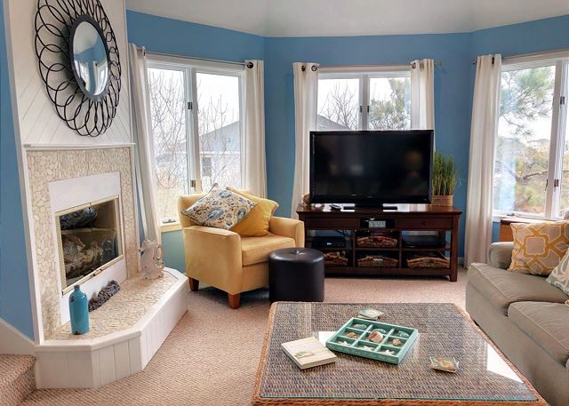 Living Room Top Level Sandy Heels is a 4 bedroom, 3.5 bathroom vacation rental in Corolla, NC