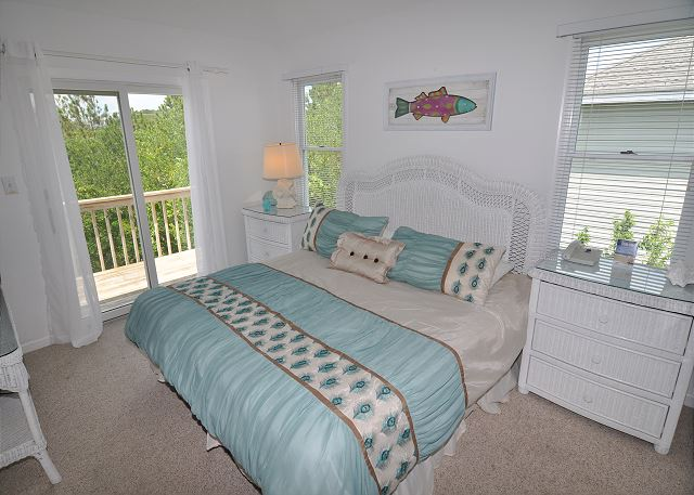 King Bedroom Top Level Sunset Strip is a 5 bedroom, 3.0 bathroom vacation rental in Corolla, NC