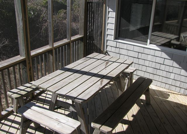 Picnic Table on Screened in Porch of Utopia, a 5 bedroom, 5.0 bathroom vacation rental in Duck, NC