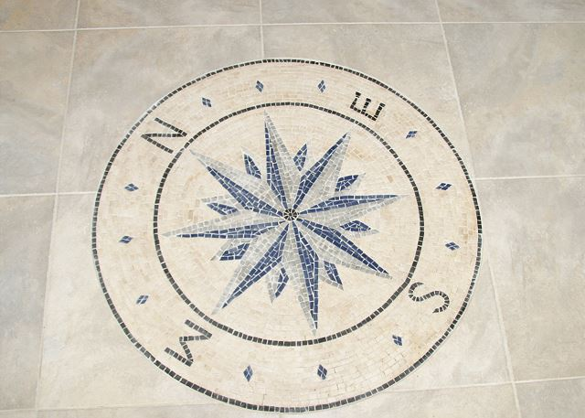 Decorative Tile of At Water's Edge, a 4 bedroom, 3.5 bathroom vacation rental in Corolla, NC