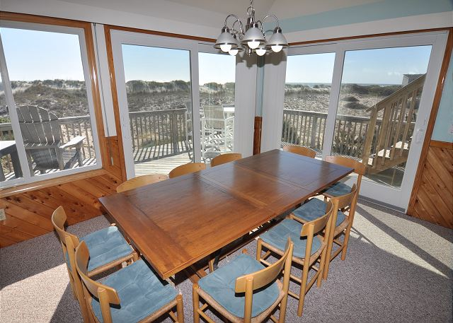 Dining Area Top Level Time To Coast is a 6 bedroom, 4.5 bathroom vacation rental in Corolla, NC