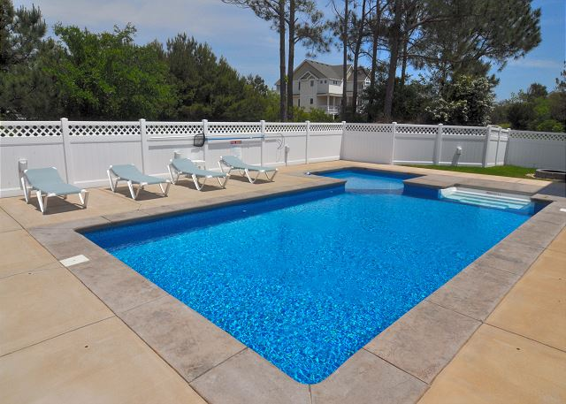 Pool Patio of Forever 409, a 6 bedroom, 5.5 bathroom vacation rental in Corolla, NC