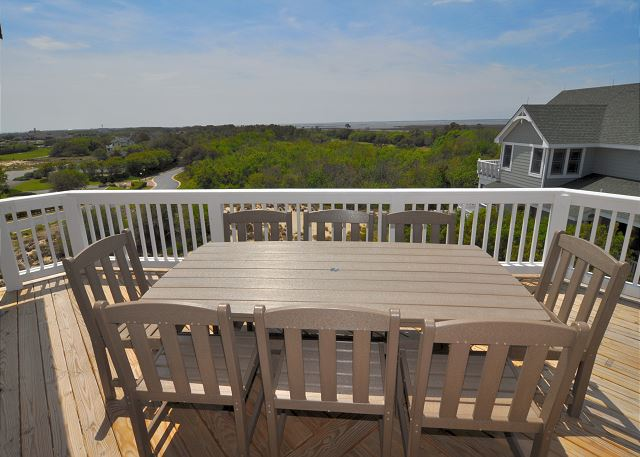 Outside Dining of Sandy Toes & Salty Kisses, a 11 bedroom, 9.5 bathroom vacation rental in Corolla, NC