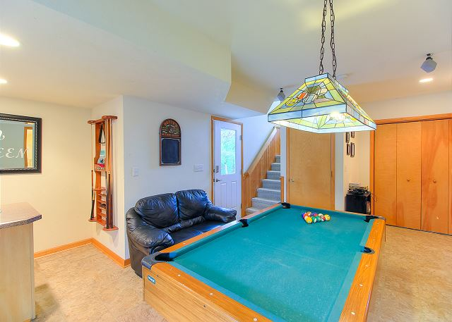 Game Room Ground Level of Sea the Green, a 7 bedroom, 5.5 bathroom vacation rental in Corolla, NC
