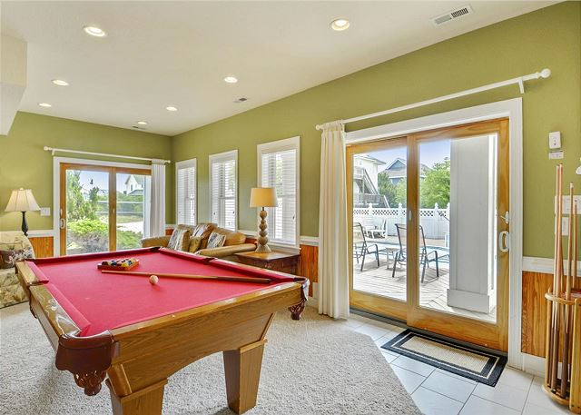 Game Area Ground Level of Coastal Castle, a 8 bedroom, 7.0 bathroom vacation rental in Corolla, NC