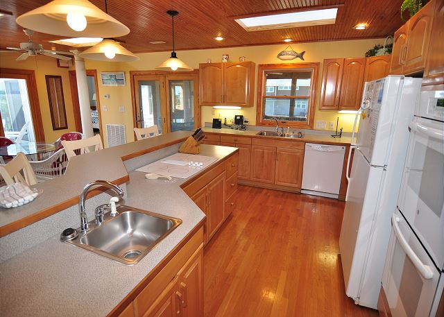 Kitchen Top Level Silver Creek is a 5 bedroom, 4.5 bathroom vacation rental in Southern Shores, NC