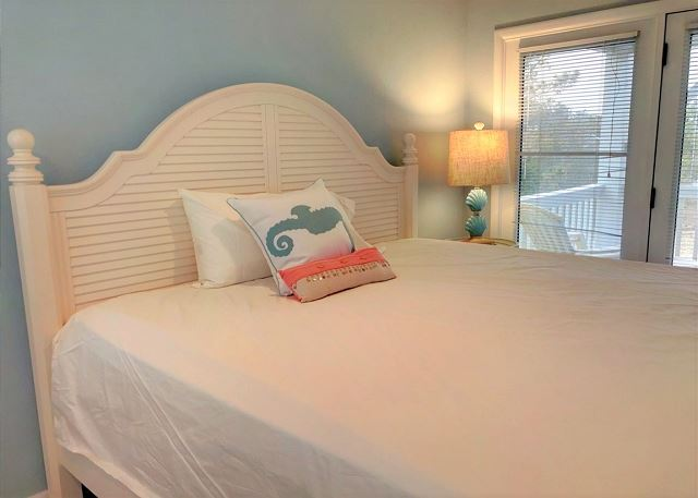 King Master Bedroom Mid Level Sandy Heels is a 4 bedroom, 3.5 bathroom vacation rental in Corolla, NC