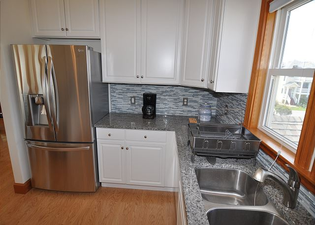 Kitchen Top Level OB Wave is a 5 bedroom, 3.5 bathroom vacation rental in Corolla, NC