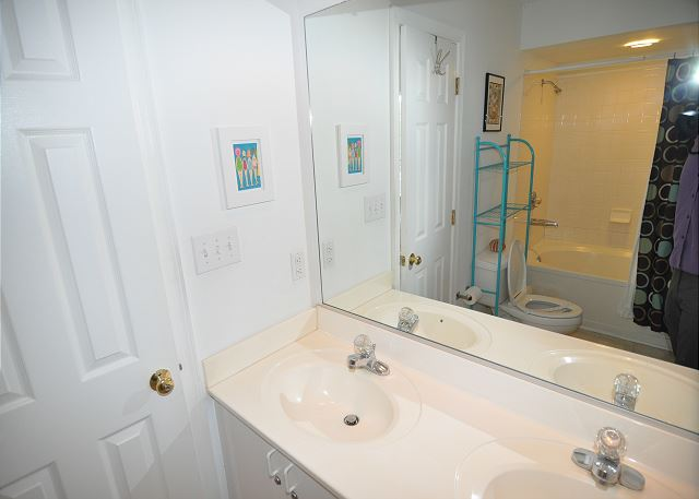 King Master Bathroom Entry Level Sunset Strip is a 5 bedroom, 3.0 bathroom vacation rental in Corolla, NC