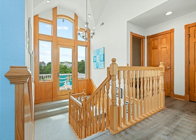 Stairs to Front Balcony and to Mid Level
