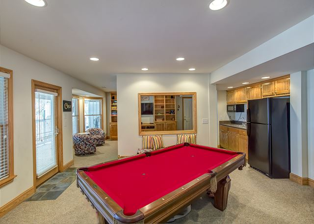 Game Room Ground Level of Ray's the Roof, a 5 bedroom, 5.5 bathroom vacation rental in Corolla, NC