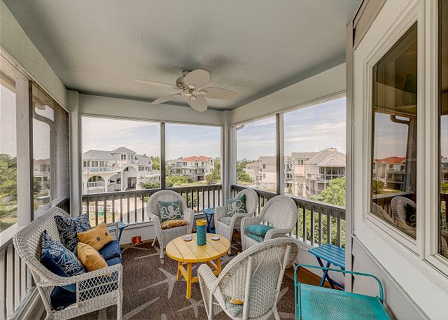 Screened Porch top level of Sandy Heels, a 4 bedroom, 3.5 bathroom vacation rental in Corolla, NC